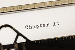 Chapter 1 written on old typewriter.