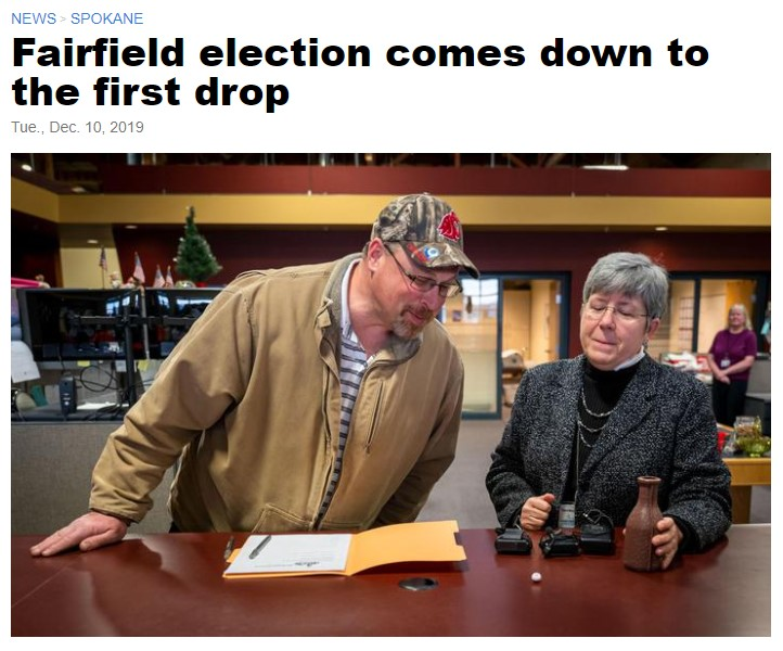 To break a 78-78 tie between two Fairfield Town Council candidates, Spokane County Auditor Vicky Dalton used two balls, each marked with a number assigned to a candidate. They were placed in a small milk bottle and then shaken. The ball that came out first marked candidate Steven Walk, on left, the winner over challenger Dave Watling, Mon., Dec. 9, 2019, at the Spokane County Elections Office. (Colin Mulvany / The Spokesman-Review)